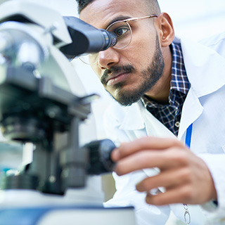 Formulation scientist looking into a microscope